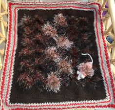 Carol Charnock Creation - batch of 2015 cat blanket and mouse. Using 'funky fur' yarns and multiple strands of brown, caramel and cream.  Highlighted by a read/cream border. Measures 24inches square.