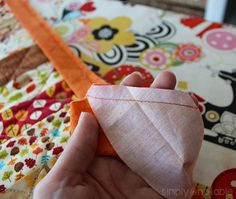 Learn how to make binding for a quilt using fabric strips rather than prepackaged bias. Also includes directions to sew it on using two different methods. | SimplyNotable.com
