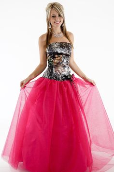 3658GN2R Ballgown with Glitter Net with two color rose, rhinestone center and streamers Sizes 2-30. Shown in Mossy Oak and fuschia glitter-net with 2 color rose and streamers Available in all camo patterns and many glitter net colors. Made in the USA.