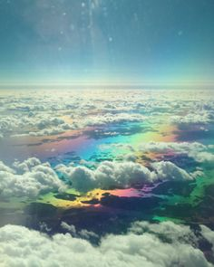 [two images taken from above the clouds. A rainbow is visible below the clouds.]