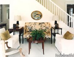 "Albert Hadley:  In a New Jersey home, the centerpiece of a cozy seating area by the stairs is an antique English settee that's still dressed in the Schumacher chintz Albert Hadley selected when he decorated for the client the first time around, forty years ago. ""You know what I also like about having that vintage fabric on this settee? It looks really nice against all this freshness,"" he said. ""There are times when it works well to have something with a ratty past."""