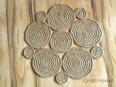Crochet natural jute rug: I think I would chain a ton of jute and then circle it and use the machine to stitch the circles into shape. Then use giant needles to connect them to one another. OR just make single or double (or half-double) crochet circles and attach (no need for a machine that way, but might be slower).