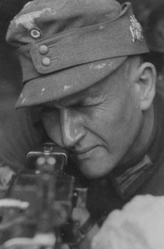 A Gebirgsjäger Alpine Infantryman aims his MG34 Machine Gun