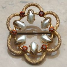 Original 1960s vintage flower brooch with faux pearls and amber colored rhinestones Create an elegant look with this pretty vintage brooch