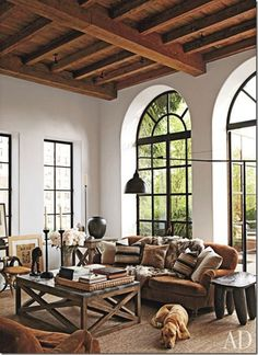 Love the steel windows and wood beams! Beautiful!