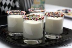 how to serve milk at a kids party.  Use a little honey or agave to rim the glass with sprinkles.