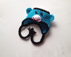 $15.00 - Baby white, blue & black crochet sock monkey beanie hat with flaps and braids, size Newborn 0-3 Months, 3-6 Months or 6-12 Months.  This hat takes the popular sock monkey toy and makes it something you can wear! This color is hard to find, so don't wait! If there is a color you want, but don't see, just ask the seller!