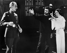 George Lucas, Carrie Fisher and Peter Cushing on the set of Star Wars: Episode IV - A New Hope (1977)