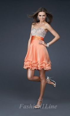 9faef895fa2 Orange dress with detailed bodice.
