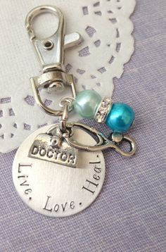 Doctor, keychain, purse clip, Live, Love, Heal. could also be a thank you gift for a Fertility Doctor, midwife, doula, nurse (with other charms) Choose color pearl. ************************** Measurement and Details: 1 inch aluminium