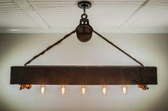Free Shipping! This rustic cedar beam with Edison bulbs is suspended by an authentic barn pulley and 3/4 inch rope. The 6x6 beam is hand planed and sealed the color of your choice to create a stunning focal point in your home or business. Each custom order is hand built, with an