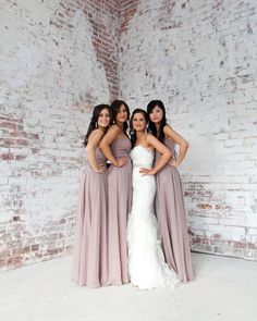 Bride and bridesmaids against brickwork