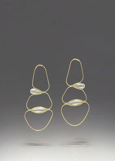 fluid earrings . inset pearls