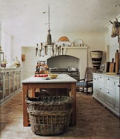 This kitchen makes me want to bake!  Fabulous French Kitchen! Fabulous French Baskets! Je Veux!