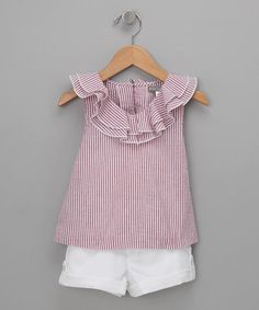 Nothing says sweet quite like this top's ruffled neckline and seersucker material. Its buttoned back and cuffed shorts make it the friendly ensemble for little ladies everywhere. Includes top and shortsCottonMachine washMade in Vietnam
