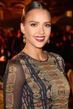 Who: Jessica Alba What: Baroque Beauty How-To: The actress and business woman looked like European royalty at the Tory Burch Paris Flagship opening last night—far from the California babe style she usually sports. A slick bun looks less severe when done with a part, as do dark lips offset by long, eye-brightening lashes and bare lids. Editor's Pick: Bite Beauty Luminous Crème Lipstick in Mulberry, $24, sephora.com.   - HarpersBAZAAR.com