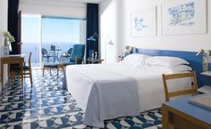 Rooms with original furniture by Gio Ponti, with balconies overlooking the sea.