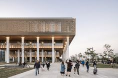 From afar, Tainan Public Library is distinguished by its large, overhanging upper floor, which is enclosed by aluminium panels adorned with ornate, floral cut-outs. Public Library Design, City Library, Modern Library, Delft, Rotterdam, Lightroom, Sunken Patio, Aluminium Cladding, Library Pictures