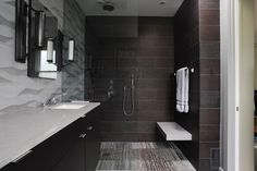 autiful San Francisco bathroom, designed by Dawn Kirker, features Zebrano floors from the Vestige collection and Ambra Gris walls from the Hand-Carved collection adds a natural flow to the room. Construction done by Devlin/Mcnally Construction.