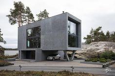 Hulppea betoniunelma minimalistisine pihoineen