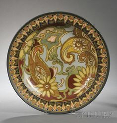 Gouda Semi-matte Glaze Pottery Charger, Holland, c. 1927, polychrome enamel decorated from the Decor Breetvelt series, with flowers and foliage.