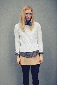 Cream cable knit sweater/navy blue blouse/camel skirt