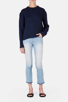 """Named for the Latin root word for love, AMO was created by denim lovers Kelly Urban and Misty Zollars to """"offer jeans that get better with every wear, yet are so comfortable you never want to take them off."""" That promise is fulfilled by the faded-to-perfection Babe. With a flattering, slightly cropped straight-leg silhouette and a higher rise, this button-fly style combines classic denim signatures—five-pocket styling, marigold topstitching—with a worn-in wash, an unstitched hem, and a…"""
