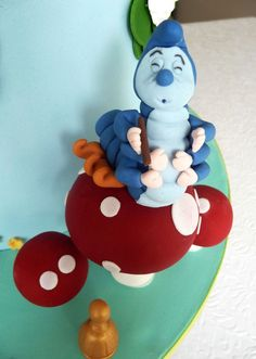 The wonderful catepillar from Alice in Wonderland, sitting on some lovely toadstools