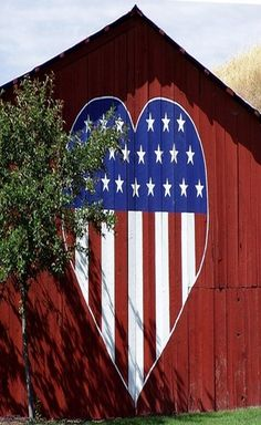 Red, White and Blue Heart painted on the side of a barn