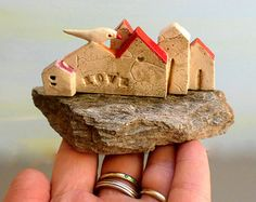Miniature ceramic houses on a quarts stone , ceramic sculpture clay houses , rustic cottages ,