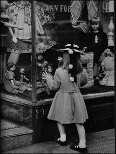 """window shopping  part of developing a great window display is understanding the target customer.  while the parent may be the one who purchases the item, the child is the true customer.  This display is from pre-WWII - late 20s or early 30s when a little girl would be very, very lucky to have one single """"store bought"""" doll ever in her possession."""