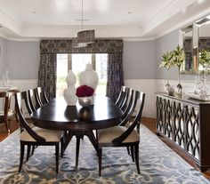 Livable Luxury Dining Room    Pretty, curved details on the chairs and sideboard make this room cohesive without feeling stiff. The elegant patterns on the rug and window treatments complement—not compete with—one another.