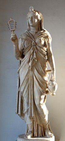 Roman Isis holding a sistrum and oinochoe and wearing a garment tied with a characteristic knot, from the time of Hadrian (117–138 AD)