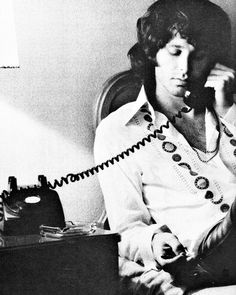 Jim Morrison talking on the telephone  talking on the telephone back in the day they all came with cords attached to them