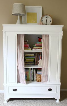 such cute storage for books, games and toys, love the curtain!