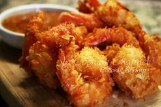Coconut Shrimp - Crunchy, light and satisfying! Served with my own refreshing concoction of pineapple, mango, strawberry and honey Dijon with a hint of cilantro dipping sauce. What a great way to bring the tropics to your table! O-M-Goodness! www.facebook.com/jncookingchannel