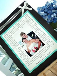 Anniversary idea? Song lyrics to our first dance around one of our wedding pictures. Hmmmm.... :)