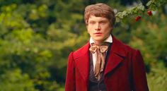 Haha! It's Simon Woods as Dr. Harrison in Cranford wearing his red cut-away coat!