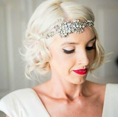 Adore this shot of our real bride Jessica. Garland on tulle with our Magnolia gown and a pop of red. Shop Online: http://store.johannajohnson.com/Products/Accessories/Headpieces/Garland_Tulle_Headband__JJA5002.aspx
