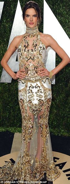 Glittering: The detailing across the bust of Alessandra's dress just managed to cover her modesty