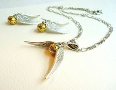 Harry Potter Golden Snitch Necklace & Earrings Set. $20.00, via Etsy. Adalia