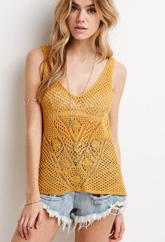 "Whether worn as a layering piece or over bikini tops at the beach, this sleeveless top is a boho babe essential! It's crafted from a beautifully designed crochet, making it a perfect match to warm, sunny days.  Lightweight 100% acrylic 27"" full length, 36"" chest, 36"" waist Measured from Small Hand wash cold Made in China"