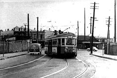 """St. Peter's Terminus. Mitchell Road and Princes Highway. End of the line for """"Alexandria via Redfern"""" tram. St. Peter's Station behind small sedan."""