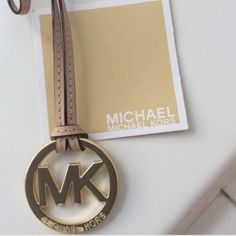 New Michael kors golden and tan charm 10 Available Bundle up and save- final price( Available 10 golden and tan bag charm) please let me know how many you need) Michael Kors Bags