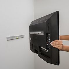 """Wall Mount to save floor space. Hangman Products No Stud TV Hanger - Mount TVs up to 48"""""""
