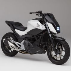 Honda unveils self-balancing motorcycle that can drive itself
