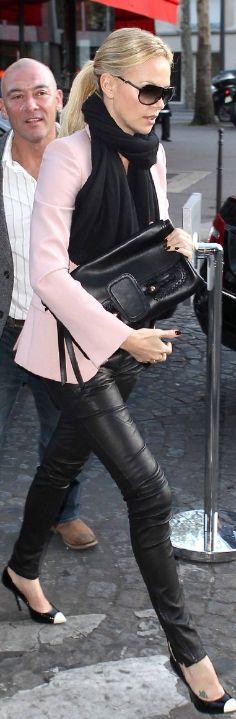 Charlize Thearon    Shoes – Giuseppe Zanotti  Purse – Alexander McQueen  Sunglasses and blazer – Stella McCartney