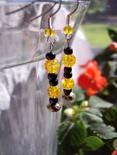 "Black and yellow glass beads on French hooks. Approximately 1"" long"