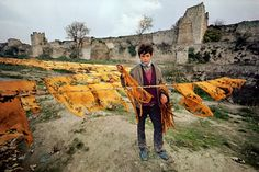 A young boy at a clothes line, Yedikule, Turkey, 1968. Photograph by Ara Güler.