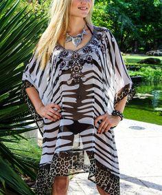 f8267a75e7d4 Black   White Animal Embellished Tunic